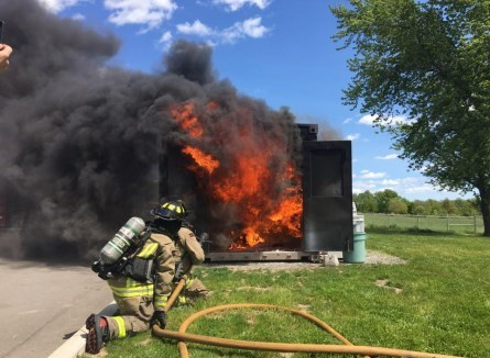 Fire department putting out shed fire